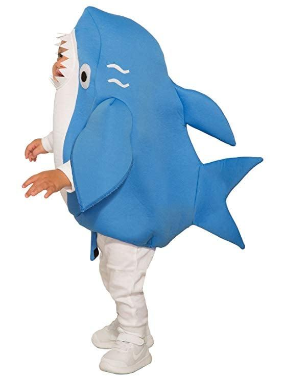 """<p>There's nothing to fear if you see a cutie in a <a href=""""https://www.popsugar.com/buy/Shark-Romper-346778?p_name=Shark%20Romper&retailer=amazon.com&pid=346778&price=9&evar1=moms%3Aus&evar9=19130532&evar98=https%3A%2F%2Fwww.popsugar.com%2Ffamily%2Fphoto-gallery%2F19130532%2Fimage%2F35746521%2FShark-Romper&list1=halloween%2Challoween%20costumes%2Ckid%20shopping%2Challoween%20for%20kids%2Cdiy%20costumes%2Ckid%20halloween%20costumes%2Challoween%20costumes%202018&prop13=api&pdata=1"""" rel=""""nofollow"""" data-shoppable-link=""""1"""" target=""""_blank"""" class=""""ga-track"""" data-ga-category=""""Related"""" data-ga-label=""""https://www.amazon.com/Forum-Novelties-Shark-Costume-Toddlers/dp/B07BY6H6YZ/ref=sr_1_15?s=apparel&amp;ie=UTF8&amp;qid=1531158000&amp;sr=1-15&amp;nodeID=7141123011&amp;psd=1&amp;keywords=shark+costume+baby"""" data-ga-action=""""In-Line Links"""">Shark Romper</a> ($9-$37) heading your way.</p>"""