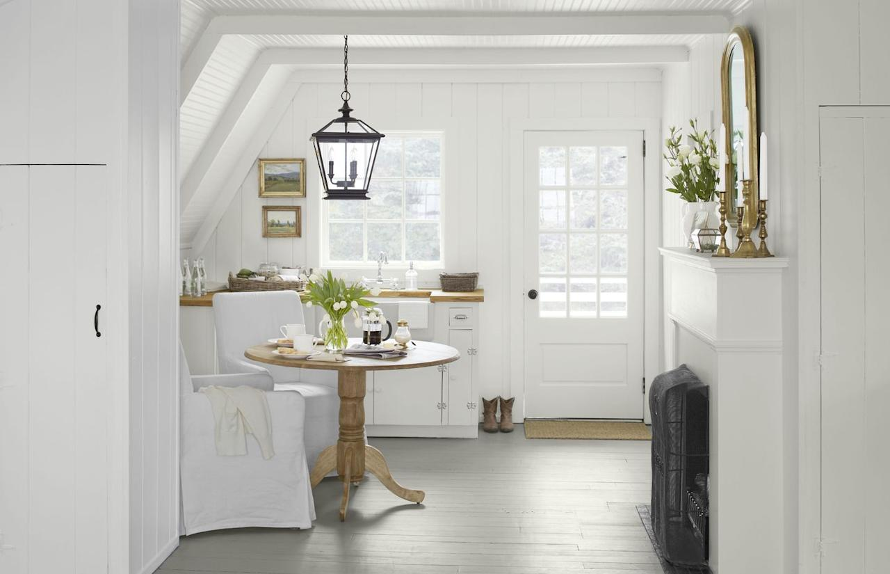 """<p>A pretty soft gray paint on breakfast nook floors grounds white furnishings and walls. The floor is painted <a href=""""https://www.benjaminmoore.com/en-us/color-overview/find-your-color/color/hc-179/platinum-gray?color=HC-179"""" target=""""_blank"""">Platinum Gray by Benjamin Moore</a>.</p>"""