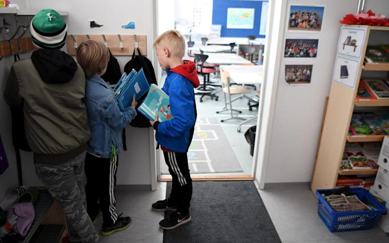 Primary school pupils returned to their classes in Helsinki last month - REUTERS