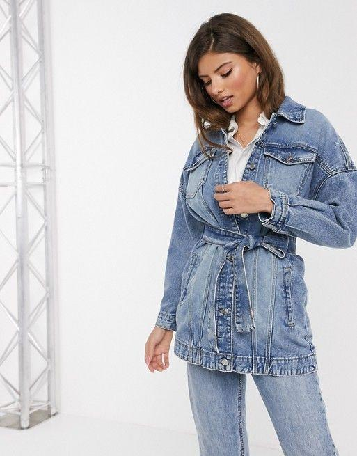 """<p><strong>Stradivarius</strong></p><p>us.asos.com</p><p><strong>$30.00</strong></p><p><a href=""""https://go.redirectingat.com?id=74968X1596630&url=https%3A%2F%2Fwww.asos.com%2Fus%2Fstradivarius%2Fstradivarius-denim-jacket-with-belt-in-blue%2Fprd%2F14378259&sref=https%3A%2F%2Fwww.goodhousekeeping.com%2Fbeauty%2Ffashion%2Fg27890498%2Fdenim-jacket-outfits%2F"""" target=""""_blank"""">Shop Now</a></p><p>This jacket already comes with a belt, so no need to add your own. But if you want to, it's removable. </p>"""