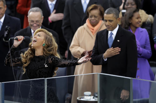 FILE - In this Jan. 21, 2013 file photo, President Barack Obama as Beyonce sings the national anthem at the ceremonial swearing-in at the U.S. Capitol during the 57th Presidential Inauguration in Washington. (AP Photo/Carolyn Kaster, file)