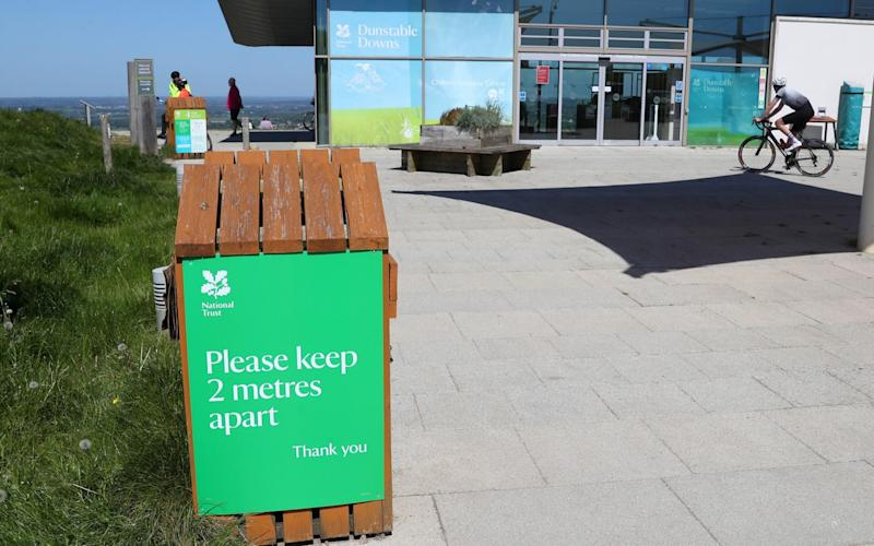 A sign at Dunstable Downs urges people to maintain a two-metre distance from each other - Catherine Ivill/Getty Images Europe