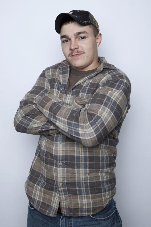 """FILE - This Jan. 2, 2013 file photo shows Shain Gandee, from MTV's """"Buckwild"""" reality series in New York. Gandee was found dead Monday, April 1, in a sport utility vehicle in a ditch along with his uncle and a third, unidentified person, authorities said. Kanawha County Sheriff's Department Cpl. B.D. Humphreys said the bodies of cast member, Shain Gandee, 21, his uncle David Gandee, 48, and the third person were found Monday near Sissonville. (Photo by Amy Sussman/Invision/AP, file)"""
