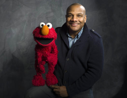 "FILE - In this Jan. 24, 2011 file photo, Elmo puppeteer Kevin Clash poses with the ""Sesame Street"" muppet in the Fender Music Lodge during the 2011 Sundance Film Festival in Park City, Utah. Another Florida man is suing Clash, the former Elmo puppeteer who resigned amid sex abuse allegations, claiming the voice actor befriended him in Miami and promised to be a father figure before flying him to New York to have sex with him. (AP Photo/Victoria Will, File)"