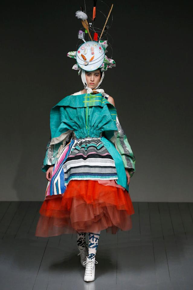 <p>Matty Bovan is not one to stick to the rule book and for his second show, milliner Stephen Jones provided the headgear once more. This time, models balanced everything from dirty dishes to wooden spoons upon their heads and it was Insta-gold. Photo: Getty </p>