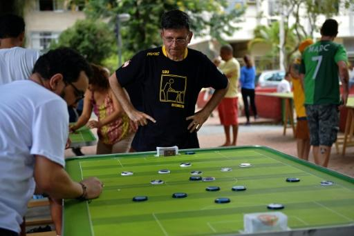 Alexandre Cerqueira Gil, a lawyer and football fan, watches his opponent play during a button football match in Rio de Janeiro