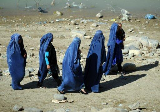 <p>File photo of Afghan women in a park in Kabul. Afghan President Hamid Karzai has ordered the release of a woman who was jailed for adultery after being raped following outcry over the case. However, the woman now faces having to marry her attacker.</p>