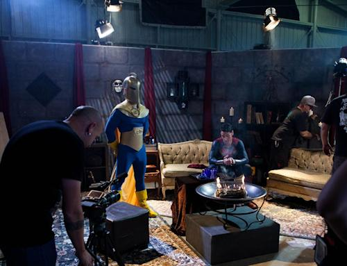 "This undated photo provided by Vivid Entertainment Group shows Ryan Driller, seated center, portraying Superman on the set ""Man of Steel XXX: A Porn Parody"" in Los Angeles. The film, released three years ago, became the biggest-selling porn movie of the year and inspired a seemingly endless succession of imitators starring the likes of Superman, Spider-Man, Ironman, The Incredible Hulk and Wonder Woman. (AP Photo/Vivid Entertainment Group)"