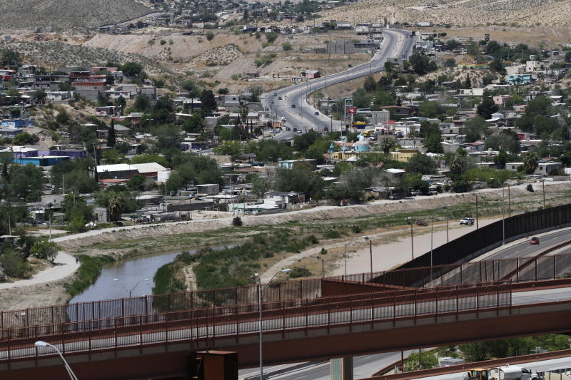FILE - This April 22, 2020, file photo, shows Juarez, Mexico, and the Rio Grande from El Paso Texas. U.S. border agencies quickly expelled about 600 child migrants in April after federal agencies began prohibiting asylum claims at the southern border, citing the coronavirus pandemic. (AP Photo/Cedar Attanasio, File)