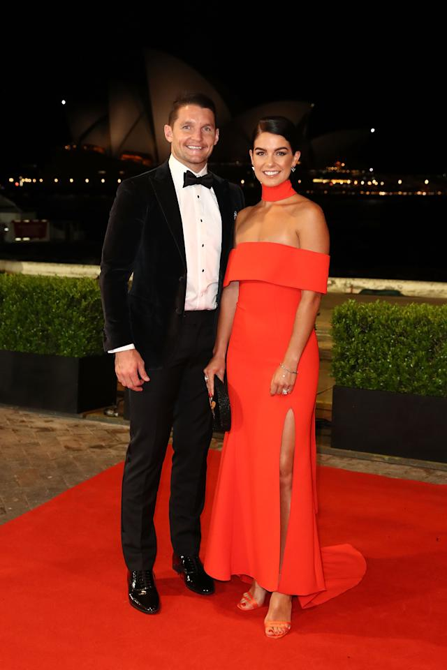 <p>Canberra Raiders player Jarrod Croker with partner Brittney Wicks, who went for a bright red number featuring a thick choker. Photo: Getty </p>