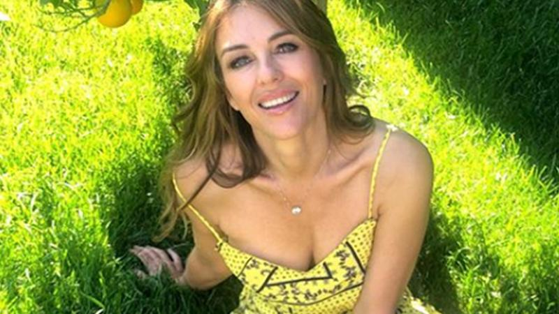 A photo of Elizabeth Hurley in a yellow dress.