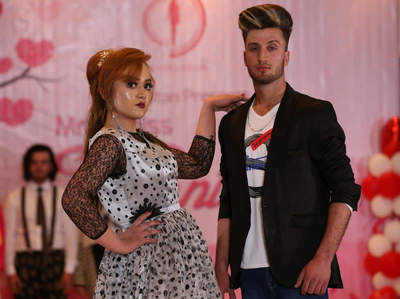 Afghan models parade on the catwalk during the fashion show, as they celebrate Valentine's Day in Kabul