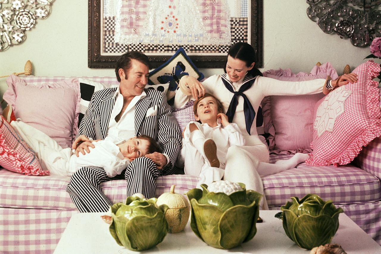 """<p>Cooper was born on June 3, 1967 to <a href=""""https://people.com/style/everything-anderson-cooper-said-about-mom-gloria-vanderbilt/"""">socialite Gloria Vanderbilt</a> and actor and screenwriter Wyatt Cooper. Here, he's pictured lying on his father's lap alongside his mother and brother, Carter in 1972.</p>"""