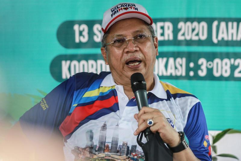 Federal Territories Minister Tan Sri Annuar Musa speaks to reporter after attending the Bukit Kiara Public Park Beautification Programme in Kuala Lumpur September 13, 2020. — Picture by Ahmad Zamzahuri
