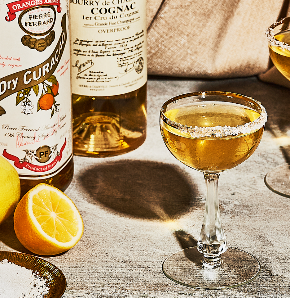 "<p><em>Regal yet festive, a Sidecar brings some glamour to an otherwise fusty day of tradition.</em></p><p><strong>Ingredients</strong><br>• 1 oz. cognac<br>• 1 oz. orange liqueur<br>• 1/2 oz. lemon juice<br>• 1/2 oz. simple syrup<br>• 1 splash lime juice</p><p><strong>Directions</strong><br>Sugar half the rim of a cocktail glass. Combine all ingredients with ice in a cocktail shaker. Shake until chilled. Strain into the glass.</p><p><a class=""body-btn-link"" href=""https://www.esquire.com/food-drink/drinks/recipes/a3774/sidecar-drink-recipe/"" target=""_blank"">Read More</a></p>"