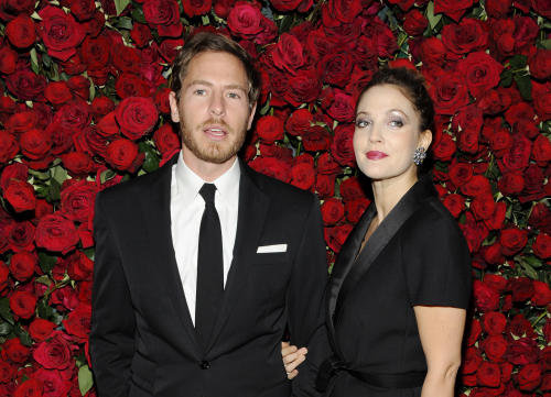 FILE - In this Nov. 15, 2011 file photo, actress Drew Barrymore, right, and boyfriend Will Kopelman attend The Museum of Modern Art Film Benefit tribute to Pedro Almodovar, in New York. A spokesman for the 38-year-old entertainer says Barrymore and her husband, Kopelman, are expecting their second child. Publicist Chris Miller offered no other details Monday, Nov. 4, 2013. (AP Photo/Evan Agostini)