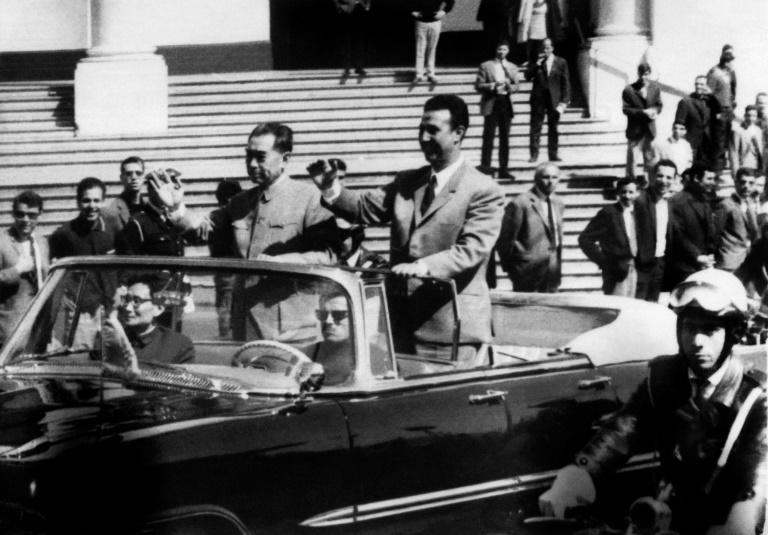 Then Algerian president Ahmed Ben Bella and Chinese prime minister Chou En Lai wave to the crowd in Algiers in March 1965