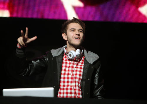 "FILE - This Dec. 9, 2012 file photo shows Anton Zaslavski aka Zedd performing during the 93.3 FLZ Jingle Ball at the Tampa Bay Times Forum in Tampa, Fla. One of the hottest young DJs and producers in music, the baby-faced 24-year-old has two songs on the charts, the deluxe edition of his debut album ""Clarity"" out this week and he's finishing music for Lady Gaga's forthcoming album ""ARTPOP."" (Photo by John Davisson/Invision/AP, File)"