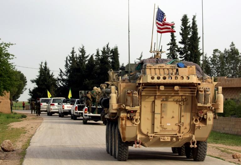 US forces, accompanied by Kurdish People's Protection Units (YPG) fighters, drive their armored vehicles near the northern Syrian village of Darbasiyah, on the border with Turkey in April 2017
