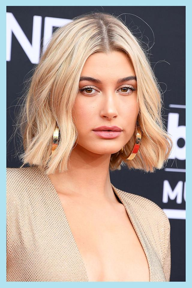 """<p>Wanna go for a laidback '90s vibe? Using a <a href=""""https://www.amazon.com/Handmade-Coarse-Toothed-Sawcut-Large/dp/B002IZN2DC/"""" target=""""_blank"""">fine-tooth comb</a>, part your hair right down the middle (the sleeker and blunter, the better). The best thing about this hair part is that you don't have to worry too much about the styling—<strong>go for loose waves à la Hailey Baldwin</strong> or make it your own with a <a href=""""https://www.cosmopolitan.com/style-beauty/beauty/a20649046/high-ponytail-how-to/"""" target=""""_blank"""">high pony</a>.<br></p>"""