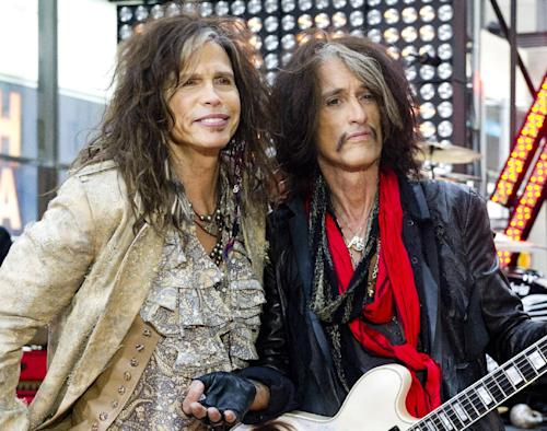 "FILE - This Nov. 2, 2012 file photo shows Steven Tyler, left, and Joe Perry of Aerosmith on NBC's ""Today"" show in New York. Perry and Tyler of Aerosmith and Mick Jones and Lou Gramm of Foreigner will join the Songwriters Hall of Fame this year along with the writers of iconic rock hits ""Love Is a Battlefield"" and ""Heartache Tonight"" during a June 13 ceremony in New York.(Photo by Charles Sykes/Invision/AP, file)"