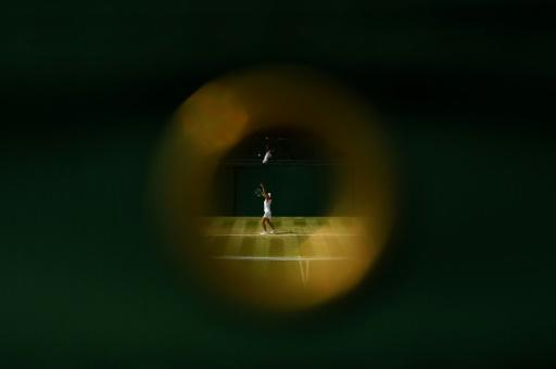 France's Manon Leonard throws the ball to serve during a girls' singles match