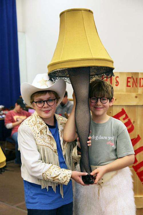 "In this Oct. 26, 2012, photo, Joe West, left, and Johnny Rabe hold a lace-stocking-clad leg lamp, one of the props from ""A Christmas Story, the Musical"" in New York. Both 12-year-old boys are making their Broadway debuts playing Ralphie in the stage adaptation of the cult 1983 film. (AP Photo/Mark Kennedy)"