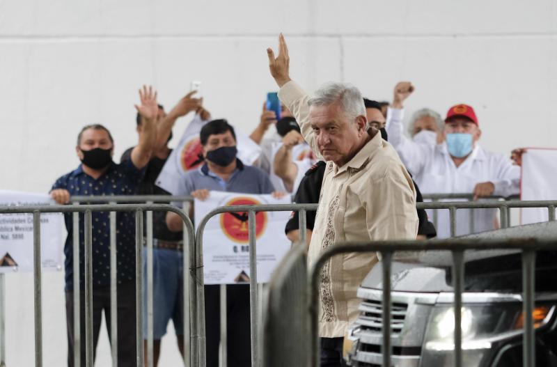 "Mexican President Andres Manuel Lopez Obrador waves to supporters in Lazaro Cardenas, Quintana Roo state, Mexico, Monday, June 1, 2020. Amid a pandemic and the remnants of a tropical storm, President Lopez Obrador kicked off Mexico's return to a ""new normal"" Monday with his first road trip in two months as the nation began to gradually ease some virus-inspired restrictions. (AP Photo/Victor Ruiz)"