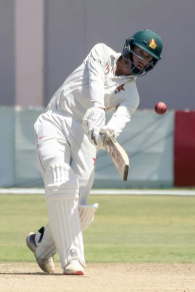 Zimbabwe captain Sean Williams on the charge during his innings of 107