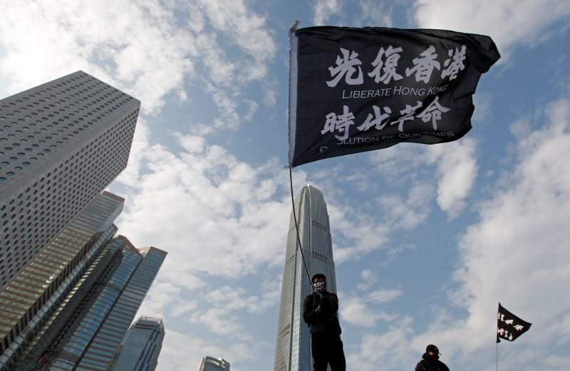 An anti-government protester waves a flag during a protest at Edinburgh Place in Hong Kong