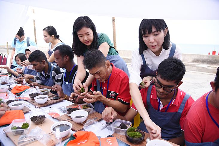 Residents from Penang Cheshire Home making their own miniature forests at a workshop by Moonshop Gallery — Pictures by Steven Ooi K.E.