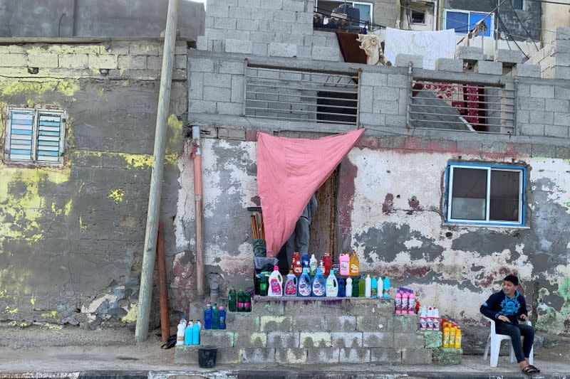 Palestinian boy sells cleaning tools and sanitizers in Gaza City
