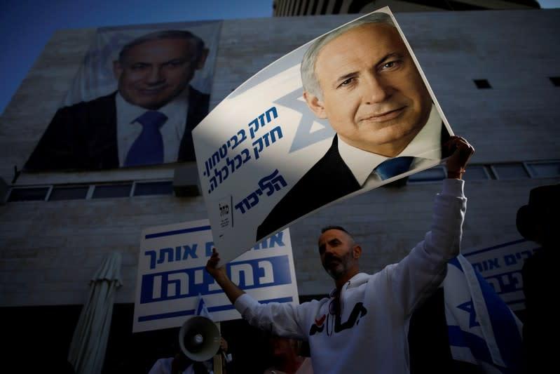Supporters of Israeli Prime Minister Benjamin Netanyahu protest outside Likud Party headquarters in Tel Aviv