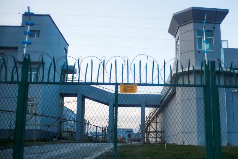 A perimeter fence is constructed around what is officially known as a vocational skills education centre in Dabancheng