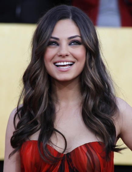 "Actress Kunis from the film ""Black Swan"" poses at the 17th annual Screen Actors Guild Awards in Los Angeles"