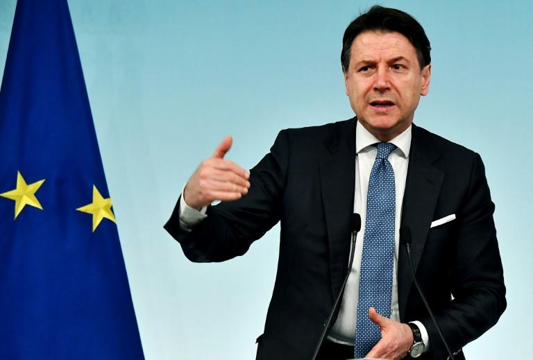 Italian Prime Minister Giuseppe Conte speaking at a press conference in Rome