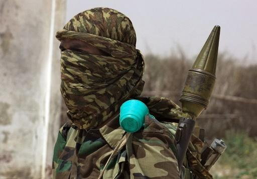 A fighter loyal to Shabaab, a jihadist group that controls swathes of Somali countryside,  drills in a village near Mogadishu in February 2011