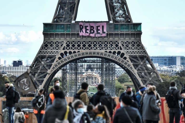 Extinction Rebellion unfurls banner on Eiffel Tower