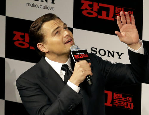 "FILE - In this Thursday, March 7, 2013 file photo, actor Leonardo DiCaprio waves to fans upon arrival for a premiere of his new film ""Django Unchained"" in Seoul, South Korea. The Hollywood film ""Django Unchained"" has been pulled from Chinese theaters on its opening day, despite weeks of promotion for director Quentin Tarantino's violent slave-revenge saga. Movie theaters throughout China said Thursday, April 11, 2013 that they were ordered to suspend the film. (AP Photo/Lee Jin-man, File)"