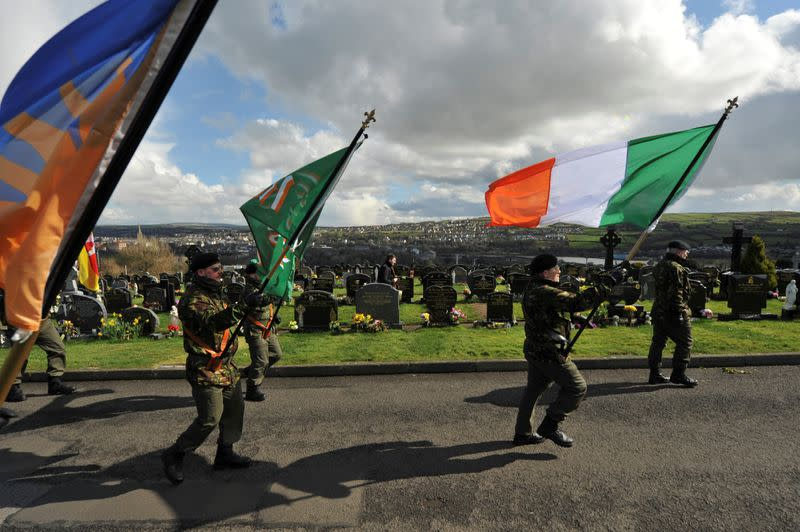 FILE PHOTO: Members of the 32 County Sovereignty Movement parade in Creggan Cemetery during a commemoration of the 100 year anniversary of the 1916 Irish Easter Rising