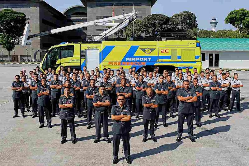 You will have an opportunity to take pictures with these men when you sign up for Malaysia Airports' 'Airport Staycation' this weekend. — Photo via Facebook/ Airport Fire and Rescue Service-AFRS, KLIA