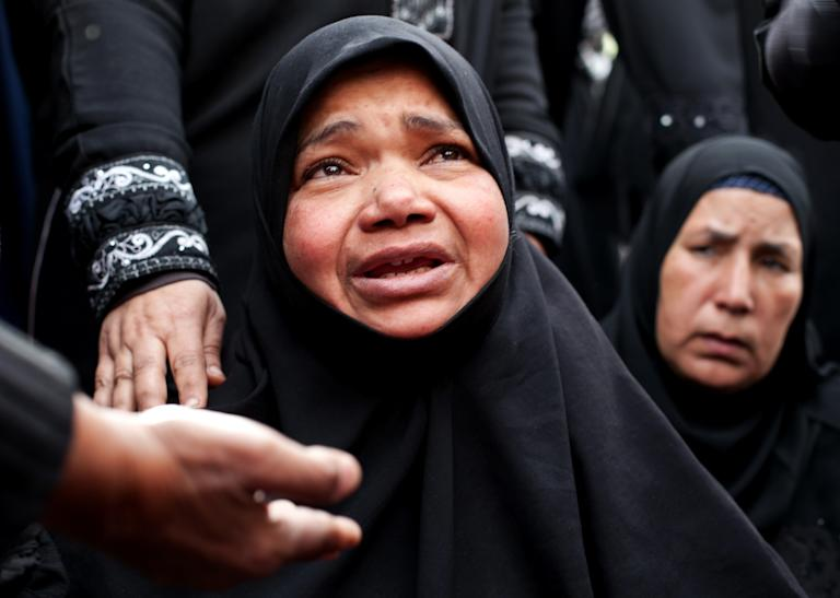 Women mourn for their relative, Ahmed Abdul Khalim, 24, who was killed with a bullet to his head during recent clashes with Egyptian security forces in Port Said, Egypt, Friday, March 8, 2013. Egypt's police forces have withdrawn from the streets of this restive city on the Suez Canal, handing over security to the military after nearly a week of deadly clashes.(AP Photo/Ariana Drehsler)
