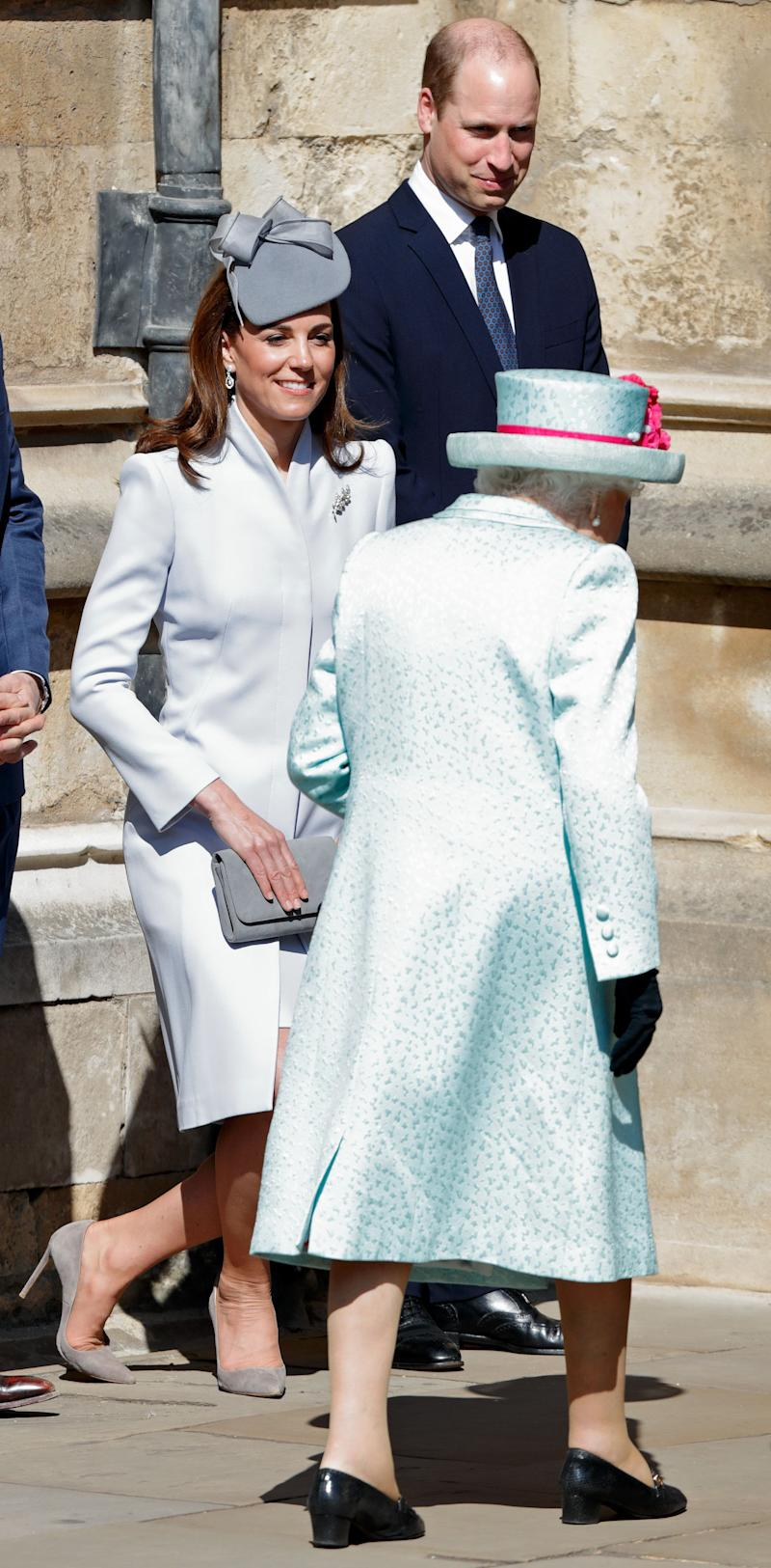 WINDSOR, UNITED KINGDOM - APRIL 21: (EMBARGOED FOR PUBLICATION IN UK NEWSPAPERS UNTIL 24 HOURS AFTER CREATE DATE AND TIME) Prince William, Duke of Cambridge looks on as Catherine, Duchess of Cambridge curtsies to Queen Elizabeth II as they attend the traditional Easter Sunday church service at St George's Chapel, Windsor Castle on April 21, 2019 in Windsor, England. Easter Sunday this year coincides with Queen Elizabeth II's 93rd birthday. (Photo by Max Mumby/Indigo/Getty Images)