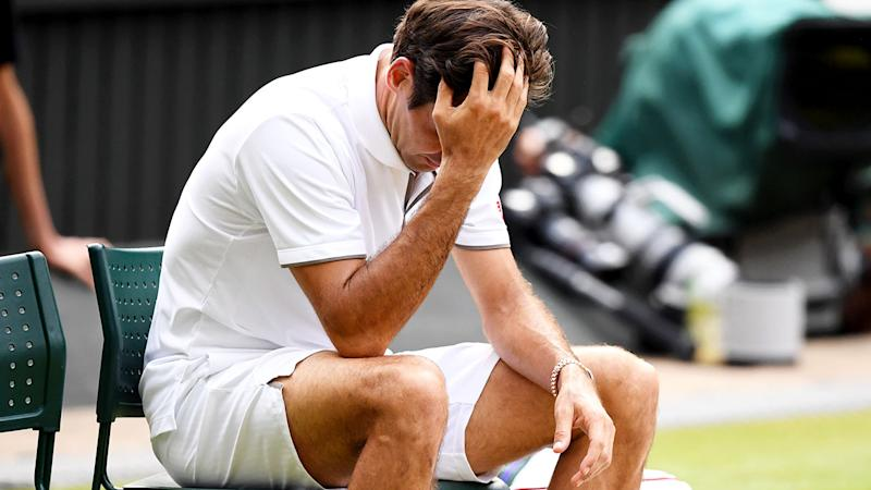 Roger Federer was shattered after the loss. (Photo by Matthias Hangst/Getty Images)