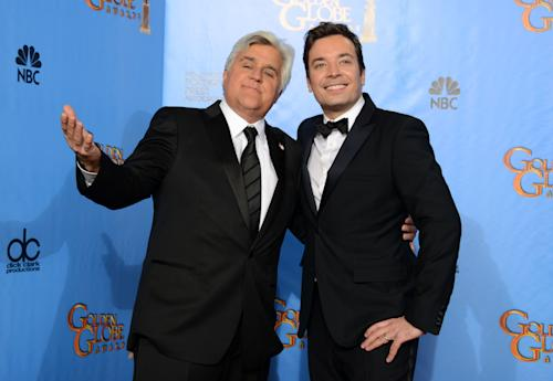 "FILE - This Jan. 13, 2013 file photo shows Jay Leno, host of ""The Tonight Show with Jay Leno,"" left, and Jimmy Fallon, host of ""Late Night with Jimmy Fallon"" backstage at the 70th Annual Golden Globe Awards in Beverly Hills, Calif. As Jay Leno lobs potshots at ratings-challenged NBC in his ""Tonight Show"" monologues, speculation is swirling the network is taking steps to replace the host with Jimmy Fallon next year and move the show from Burbank to New York. NBC confirmed Wednesday, March 20, it's creating a new studio for Fallon in New York, where he hosts ""Late Night."" But the network did not comment on a report that the digs at its Rockefeller Plaza headquarters may become home to a transplanted, Fallon-hosted ""Tonight Show."" (Photo by Jordan Strauss/Invision/AP, file)"