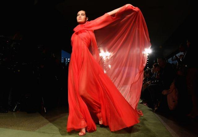 A diaphanous red look by Brandon Maxwell. New York, February 8, 2020