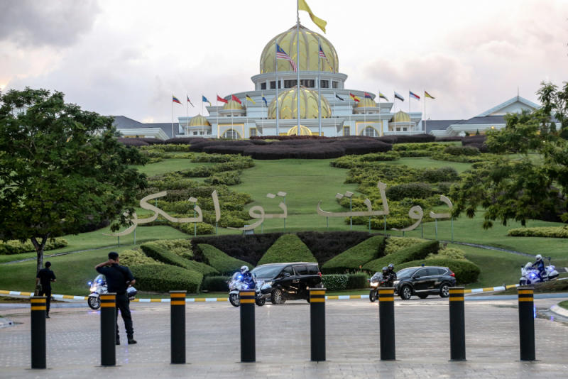 Luxury vehicles believed to be carrying senior political leaders leave Istana Negara February 23, 2020. — Picture by Firdaus Latif