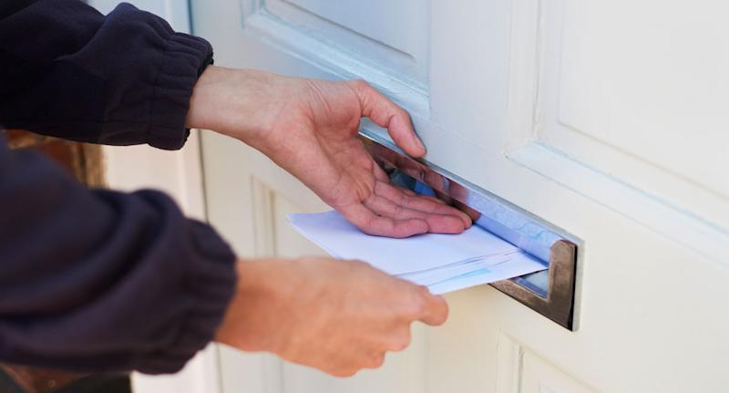 File photo of letter being slipped through a front door after a Birmingham resident received a note about his laundry.