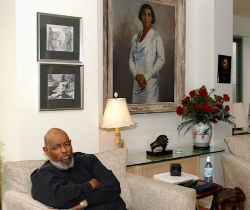 FILE - In this May 9, 2002 file photo, James DePreist, talks about his conducting career as he sits in his high rise apartment overlooking downtown Portland. A portrait of his aunt, the legendary opera singer Marian Anderson, hangs on the wall behind him. One of the early African-American conductors of a major orchestra and National Medal of Arts winner James DePreist has died at age 76. His manager, Jason Bagdade, says DePreist died at home Friday, Feb. 8. 2013 in Scottsdale, Ariz. (AP Photo/Greg Wahl-Stephens)
