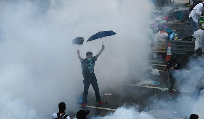 A protester raises umbrellas during Occupy Central on September 28, 2014. Photo: K. Y. Cheng